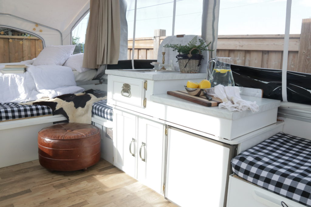 white tent trailer renovation glamping
